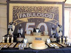 Tablescape with perfectly placed backdrop from Fabulous 50 Black & Gold Birthday Party at Kara's Party Ideas. See over 20 pictures at karaspartyideas.com!