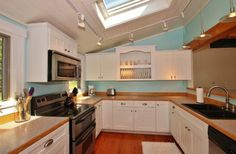 The spacious kitchen at Harrington Cove Cottage in St. George, Maine.