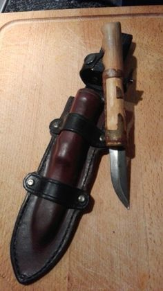 Leather sheath and woodcarving knife.