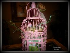 Diaper cake in a bird cage