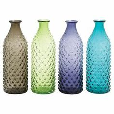 """This product is sold in sets of 4.Add a splash of color to your decor with this textured glass bottle, a graceful choice for displaying in the kitchen windowsill or holding dried flowers on the mantel.   Product: Set of 4 bottlesConstruction Material: GlassColor: Brown, green, purple, and blueDimensions: 17"""" H x 6"""" Diameter"""