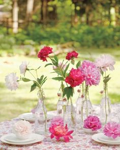 An easy and simple summer flower display using clear glass bottles.