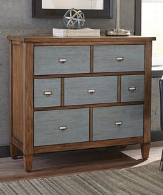 Heighten your home layout with rugged appeal thanks to this industrial-inspired accent cabinet. Three hardware-themed front drawers reveal enhanced interior storage space.