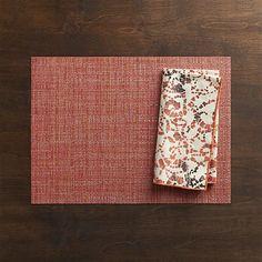 http://www.crateandbarrel.com/chilewich-crepe-coral-placemat-and-swirl-batik-napkin/f58100