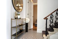 Entry/Foyer - Great floors, stairway and detailed trim on door.  Very chic.