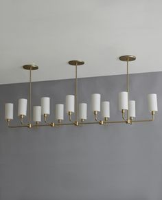 A beautiful modern chandelier - It's the Linear Suspended Cylinder Chandelier by Bone Simple Design