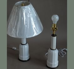 Pair of small Heiberg lamps, Denmark 20th century, in white ceramic with brass fittings. Newly rewired. Shades sold separately.  H:21, Base diameter:4.  Ref. #13-01