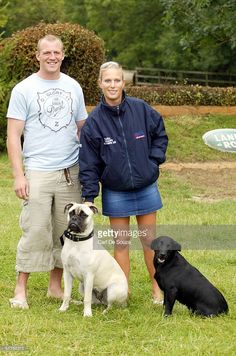 Zara Phillips, daughter of Princess Anne, stands with her dogs and her…