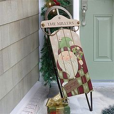 LOVE this Personalized Vintage Santa Holiday Sled! It's such a pretty Christmas decoration and you can personalize it with any family name at the top!
