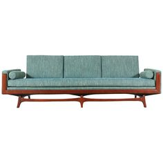Mid-Century Sofa with Sculptural Floating Walnut Base | From a unique collection of antique and modern sofas at https://www.1stdibs.com/furniture/seating/sofas/