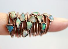 This is a handmade copper ring with beautiful tiny Australian Opal in freeform.  ***The listing is for one copper ring with free-form Tiny Opal!***  The size of the stone is about 4 - 7 mm, the band is about 1.5 - 2 mm width!  Available sizes and ready to ship are: US 9__________18.9 mm inner diameter US 9.5_________19.5 mm inner diameter US 10_________19.9 mm inner diameter  If you arent sure for your write size check here: http://www.onlineconversion.com/ring_size.htm  This ...