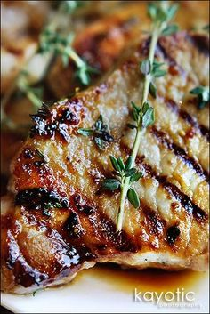 """Honey Thyme Chops from KayoticKitchen - """"Things tend to burn easy with honey in the marinade, but you'll be perfectly safe when you use pork chops that require very little cooking time or when you flatten the chicken before grilling it."""""""