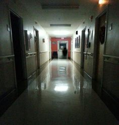 This photo was taken by a resident of a nursing home. Prior to the photograph being taken, members of the staff and other residents repeatedly heard the sounds of a door opening and closing along with the appearance of a call light turning on and off, only to find nobody was in the room. This picture had been taken roughly 15 minutes after a patient in the facility had passed on, is it possible this is the person? Or perhaps 'The Reaper'?