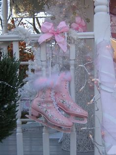 Pink Christmas ice skates painted with pink roses