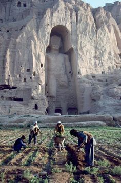 So many interesting and beautiful places in the World. I believe that this is Bamyan a valley in the centre of Afghanistan with two giant Buddhas carved out of sandstone cliffs, If so this photo was taken before the Taliban blew up the statues.