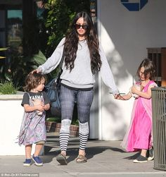Come on boys!Megan Fox looked every inch the loving mummy on Monday as she headed out to ...