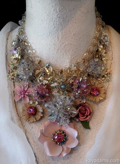 Pink and blue brooches, earrings and gold metals make really good looking necklace.