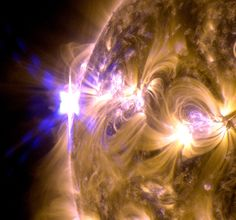 The sun erupted with an X1.7-class solar flare on May 12, 2013. This is a blend of two images of the flare from NASAs Solar Dynamics Observatory: One image shows light in the 171-angstrom wavelength, the other in 131 angstroms.  Credit: NASA/SDO/AIA