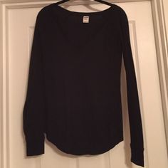 Pink Victoria's Secret black waffle knit t shirt Pink Victoria's Secret black waffle knit t shirt. Long sleeves. Banded at wrists. Scoop bottom. PINK Victoria's Secret Tops Tees - Long Sleeve