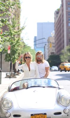 Top down, worry free: Kelly Framel (@theglamourai) and Zach show their Ralph Lauren Automotive eyewear style. The eyewear collection features auto-inspired details like aluminum and perforated leather tips.