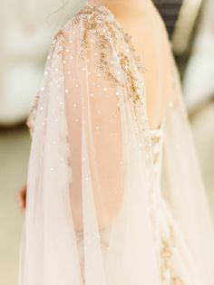 Gorgeous beaded bridal cape: http://www.stylemepretty.com/2015/12/22/los-angeles-night-at-the-museum-wedding/ | Photography: Honey Honey - http://www.hoooney.com/