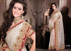 OFF WHITE SARI WITH HEAVY EMBROIDERED BORDER
