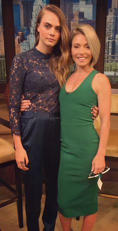 Kelly Ripa in a Kelly Green Victoria Beckham dress with Cara delevingne in Femme Darmes. LIVE with Kelly and Michael Fashion Finder.
