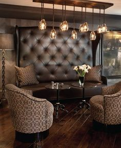 Love wood floors, lighting and matching pillows/chairs Tea room inspo. Bar Lounge, Lounge Areas, Cigar Lounge Decor, Lounge Seating, Cigar Lounge Ideas, Brown Lounge, Cafe Seating, Booth Seating, Jeff Andrews Design