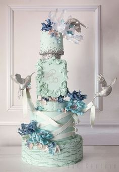 Gorgeously unique pale green wedding cake topped with blue flowers Featured Cake: Kek Couture; Gorgeously unique pale green wedding cake topped with blue flowers Amazing Wedding Cakes, Elegant Wedding Cakes, Wedding Cake Designs, Amazing Cakes, Gorgeous Cakes, Pretty Cakes, Bird Cakes, Cupcake Cakes, Pale Green Weddings