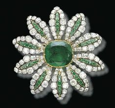A DELICATE ANTIQUE EMERALD AND DIAMOND BROOCH Designed as a flowerhead, the centre set with a cushion-shaped emerald weighing carats, each bombé petal set with a line of square-shaped emeralds within an old-cut diamond surround, mounted in silver a Modern Jewelry, Fine Jewelry, Dainty Jewelry, Antique Jewelry, Vintage Jewelry, Emerald Jewelry, Prom Jewelry, Bridesmaid Jewelry, Diamond Brooch