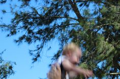 Motion Blur- TV Mode, ISO 200, f/22, 1/50 Taken in the backyard with my husband throwing our son up in the air. Used a tripod to allow for as much still motion as possible.