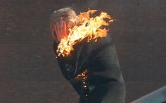 An anti-government protester is engulfed in flames during clashes with riot police outside Ukraine's parliament in Kiev, Ukraine, Tuesday, Feb. 18, 2014. Thousands of angry anti-government protesters clashed with police in a new eruption of violence following new maneuvering by Russia and the European Union to gain influence over this former Soviet republic.