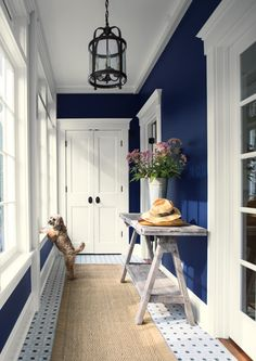 Bold and Memorable Entryways Bold and Memorable Entryways Use your entryway to make a lasting impression. A combination like navy and white is classic, yet bold and memorable. (WALL) Old Navy Aura®, Eggshell (TRIM) Simply White Aura®, Semi-Gloss Best Blue Paint Colors, Blue Wall Colors, Most Popular Paint Colors, Aura Colors, Blue Colour Palette, Accent Colors, Entryway Paint Colors, Hallway Paint, Hallway Colours