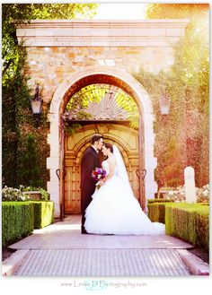 Bride and groom sharing and intimate moment outside under the arches here at Villa Siena! #bride #groom #wedding #kiss #forehead #bouquet #Arizona #VillaSiena