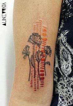 Aline Wata flower tattoo