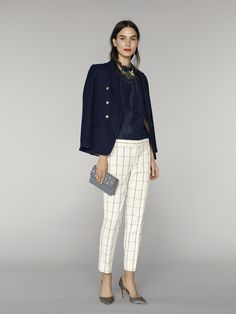 This navy blouse is perfectly complimented by chic white check pants. Add a blazer and a bold chunky necklace for a summer night out | Banana Republic Summer '16