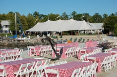 Rehearsal dinner set up on the pier with the Wedding tent in the background. August 2013.