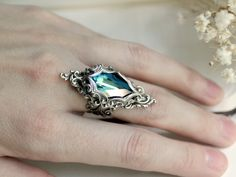 Keopelani Lady Aqua ring:     Lady of the Ocean Aged Silver and Swarovski Ring- Blue - Aqua - Silver - Victorian - Fantasy - Water - Summer - Bridal. $55.00, via Etsy.