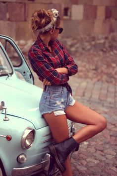 pin up chica, flannel shirt, jeans short, boots, headband and sunglasses. All in retro style. Sexy girl;)