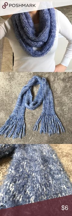 Periwinkle blue fuzzy scarf Periwinkle blue soft and fuzzy scarf. This scarf is very soft and cozy. You can wear it so many ways!      75% Nylon , 25% Polyester Accessories Scarves & Wraps