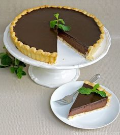 A silky, smooth chocolate-mint tart with an easy, press-in shortbread crust and a glossy ganache glaze. This is an elegant dessert for a special occasion.