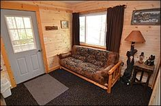 Living room with futon http://clamlakewi.com/bearcabinrentallowerclamlakewi.htm