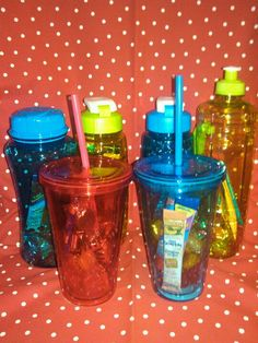 Fun participation prizes for a summer training at work or a quick thank you gift. Dollar Tree cups and water bottles filled with hard candy and shake n go drink mix. I made 11 for under $20 :-)