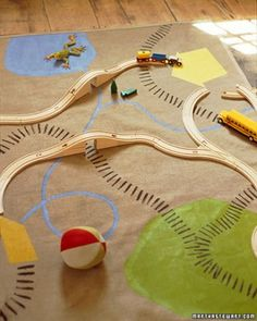 Mat-tastic fun: Painted canvas is perfect for the playroom floor. Cut to your desired size, then paint tracks, roads, swamps and stumps in your color palette! Lofs of other good ideas for playroom also