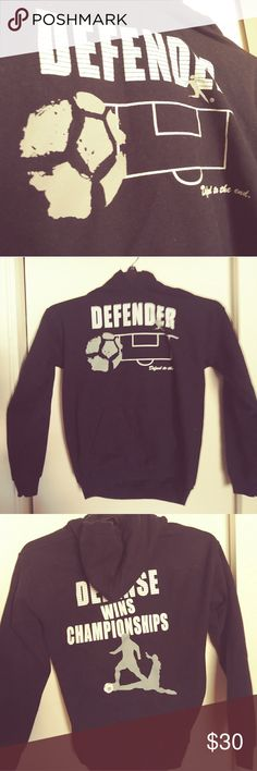 "Kids' Soccer Hoodie Kids' soccer hoodie in size youth medium. Gently/barely used. Only issue is the 2nd part of the tag is torn off (photo). The front says ""Defender. Defend to the end."" The back says ""Defense wins championships"". Color: Black Sweaters"