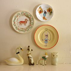 Vintage illustrated plates by The Storybook Rabbit on Etsy and porcelain figures.