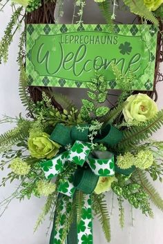 Let me help you decorate for St. Patrick's Day with a lovely oval welcome wreath for your front door using silk flowers, wired ribbon, Leprechauns Welcome sign. Get started on this DIY wreath tutorial today! Diy St Patricks Day Wreath, St Patricks Day Crafts For Kids, Diy Wreath, Wreath Making, Wreath Crafts, Diy Crafts, Welcome Wreath, St Patrick's Day Decorations, Outdoor Wreaths