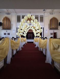 Set the perfect scene at your church ceremony with balloon arches and isle pew decor by www.focusondivas.com