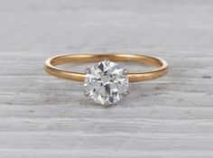 Antique Edwardian Tiffany & Co. engagement ring made in 18k yellow gold and platinum. Centered with a GIA certified 1.36 carat old European cut diamond with G color and VVS2 clarity. Signed Tiffany & Co. Circa 1928.