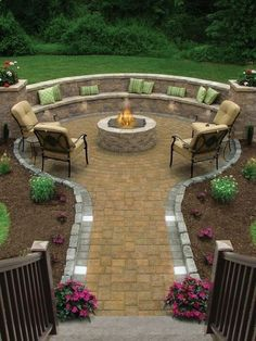 Backyard seating area with stones and mulch; low maintenance landscaping.